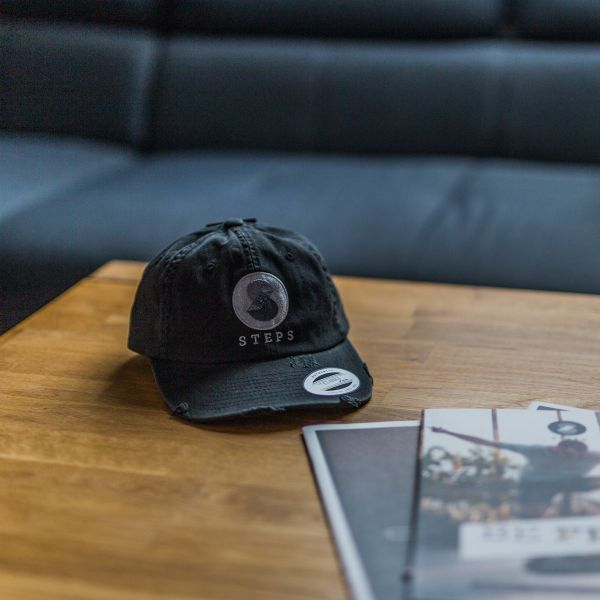 STEPS-Cap-destroyed-black